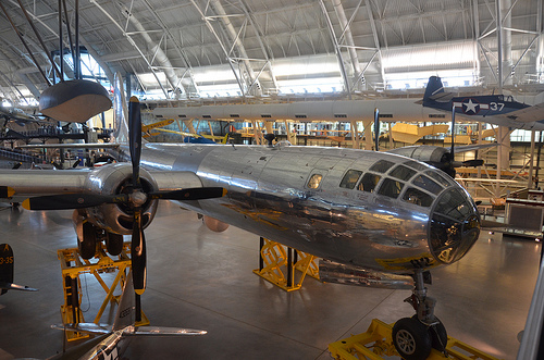 "Steven F. Udvar-Hazy Center: Boeing B-29 Superfortress ""Enola Gay"" (front starboard view), with Grumman F6F-three Hellcat at back-right, among other folks"